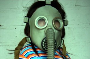 little girl with a gas mask on