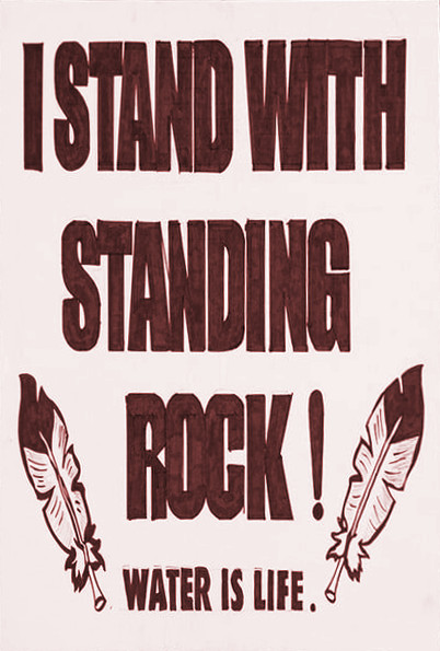 Poster saying »I stand with Standing Rock. Water is life.«